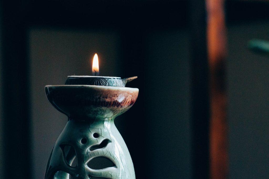 candle-light-burning-on-porcelean-candle-holder