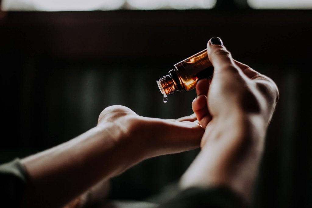 essential-oil-drop-poured-on-hand