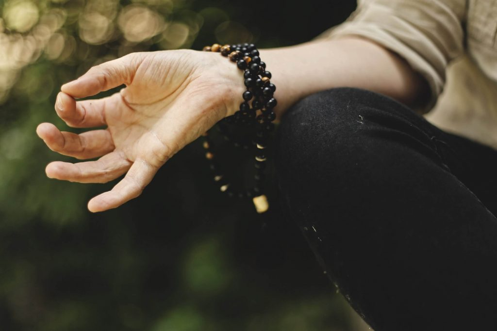 photo-of-womans-hand-who-is-doing-yoga
